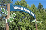 Green sign reading, &#34Miracle League Field.&#34