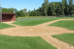 A dirt and grass baseball field.
