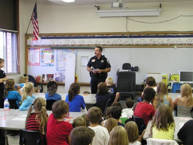 Deputy Chief McQuiston speaking to a 3rd grade class in the Junior Police Program