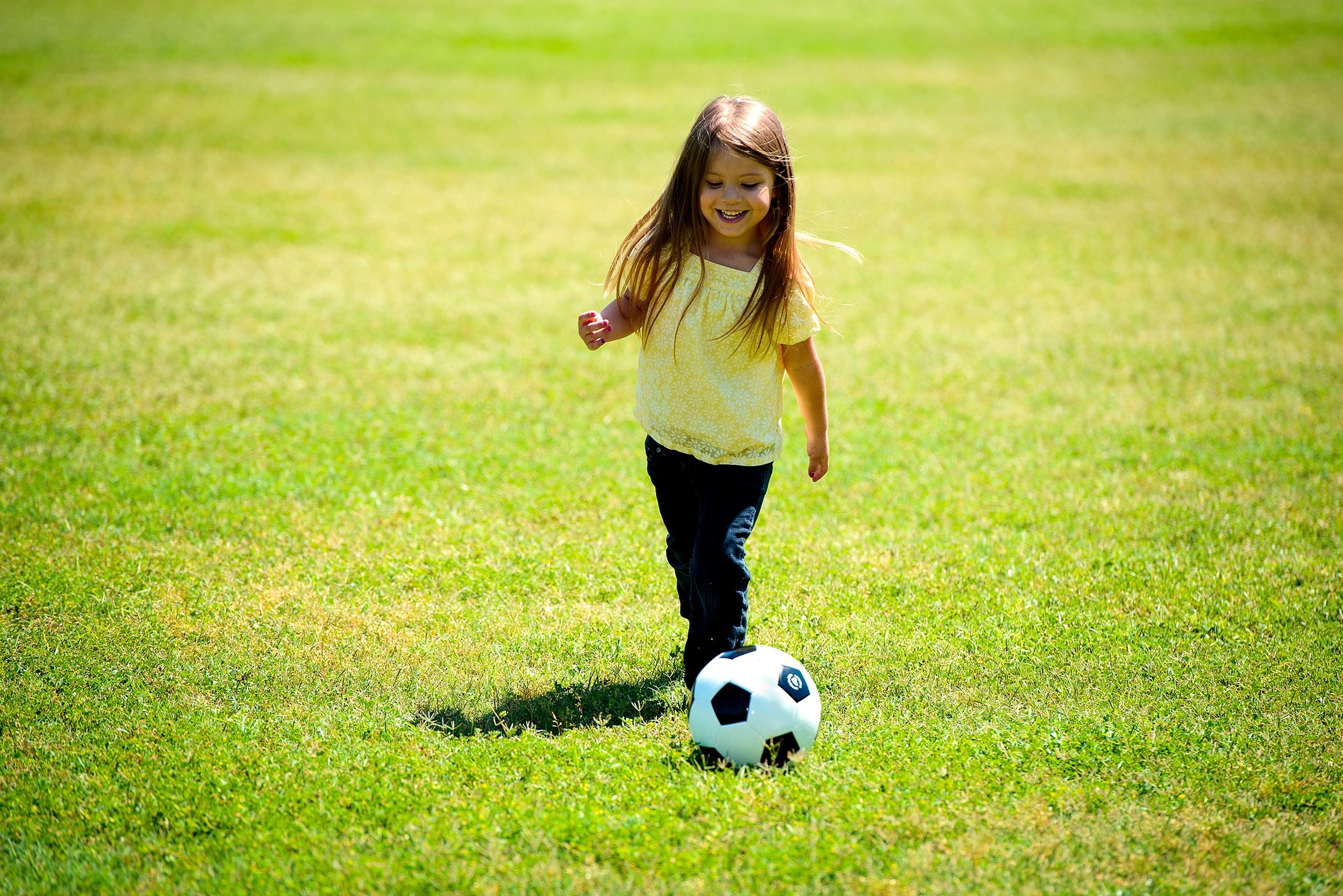Canva - Little Girl Playing Soccer