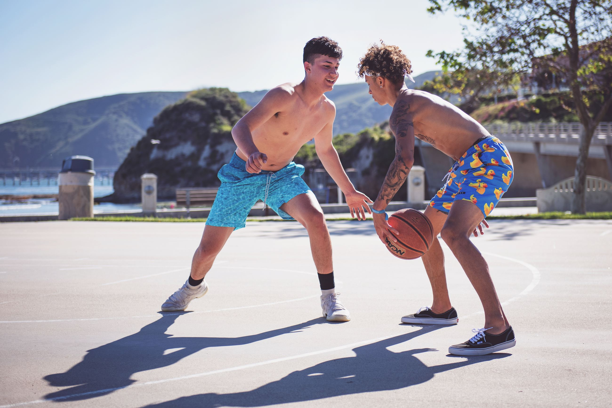 Canva - Photo Of Two Men Playing Basketball
