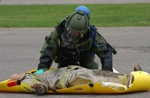 Bomb Squard Technician Rendering Aid to a Training Dummy